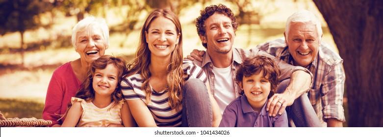 Portrait of smiling family having picnic at garden