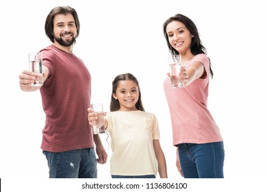 portrait of smiling family showing glasses of water in hands isolated on white