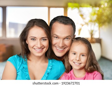 Portrait of smiling family sitting in new home