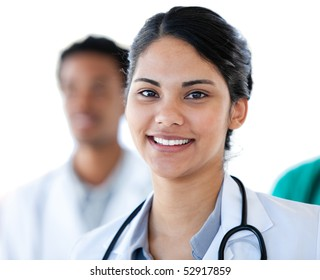 Portrait of a smiling female doctor against a white background