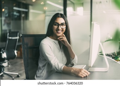 Portrait of smiling female executive in office