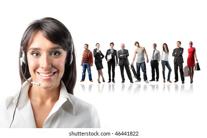 Portrait of a smiling female operator with a group of different people on the background