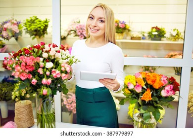 Portrait of smiling florist working in flower shop