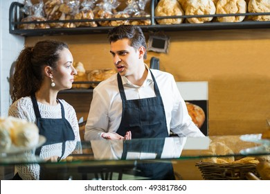 Portrait of smiling friendly couple at bakery in cafeteria