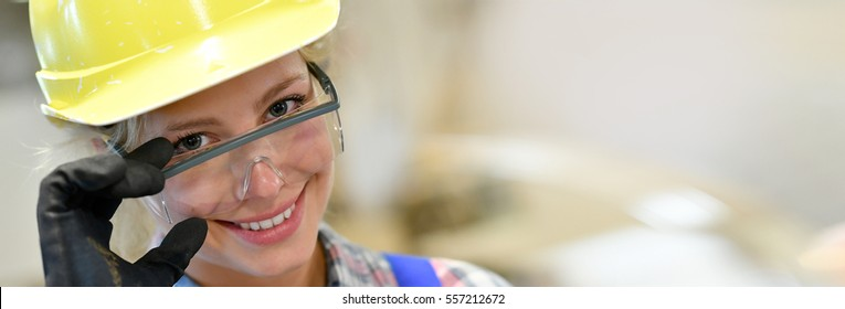 Portrait of smiling girl in construction training, template