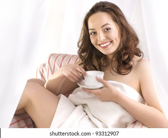 Portrait of smiling girl with cup of tea