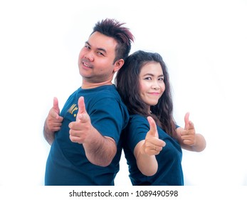 Portrait of Smiling Girl and her Boyfriend making point the finger at the camera. Happy Joyful Family. friendship Concept.
