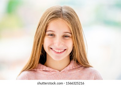 Portrait of smiling girl on blurred background close-up
