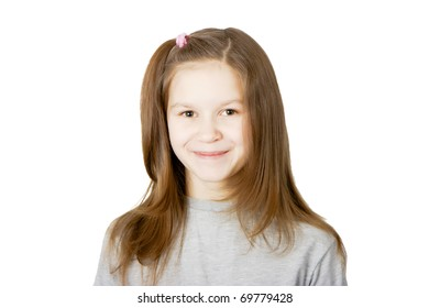 portrait of a smiling girl on white background