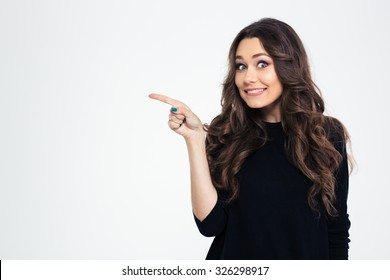 Portrait of a smiling girl pointing finger away isolated on a white background