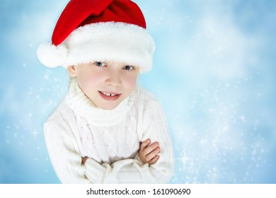 portrait of a smiling girl in a Santa hat and sweater