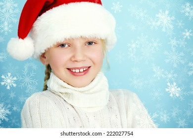 portrait of a smiling girl in a Santa hat and sweater. Christmas child