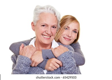 Portrait of smiling grandmother and her granddaughter
