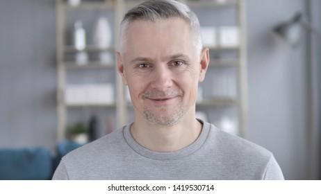 Portrait of Smiling Gray Hair Man Looking at Camera