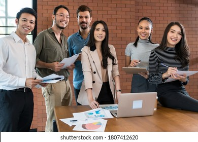 Portrait of a smiling group of diverse interracial corporate colleagues in meeting room for startup new business. Business coporate brainstorming concept for new startup team.