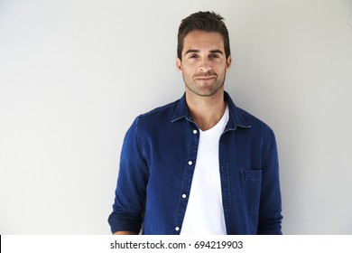 Portrait of smiling guy in blue shirt