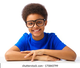 Portrait of smiling, handsom African American school boy, teenager. Studio shot, over white background, with copy space.