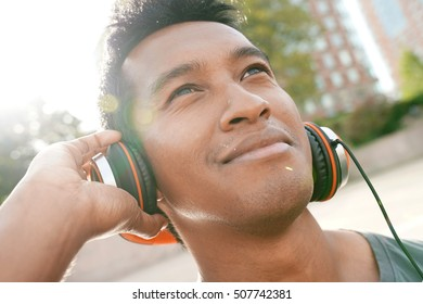 Portrait of smiling handsome asian guy with headset on