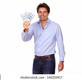 Portrait of a smiling handsome man holding cash dollars on white background