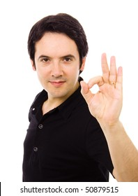 Portrait of a smiling handsome young man gesturing ok sign, against white background