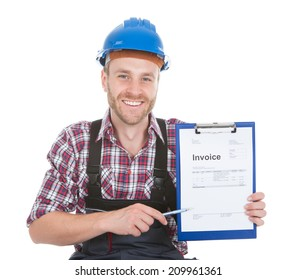Portrait of smiling handyman showing invoice on clipboard over white background
