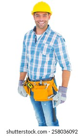 Portrait of smiling handyman wearing tool belt on white background