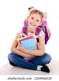 Portrait of smiling happy school girl child with school bag backpack and books isolated on a white background education concept