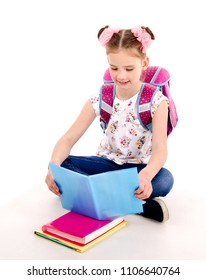 Portrait of smiling happy school girl child with school bag backpack reading a  book isolated on a white background education concept