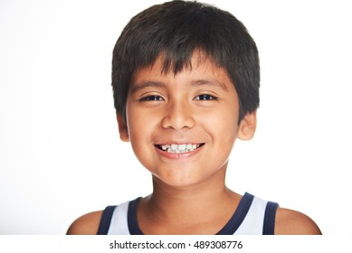 portrait of smiling hispanic boy isolated on white