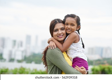 Portrait of smiling hugging mother and daughter