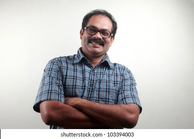 Portrait of a smiling  Indian male with folded hands
