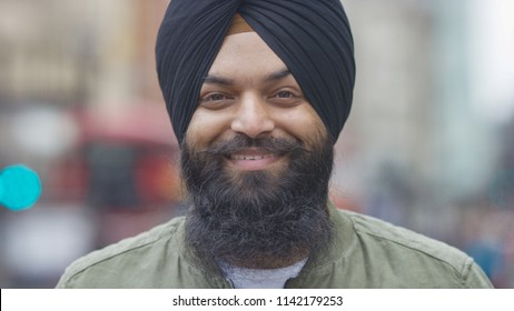 Portrait of smiling Indian male in a turban looking to camera on a street