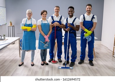Portrait Of A Smiling Janitors In Uniform At Office