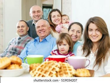 Portrait of smiling joyful multigeneration family  in home
