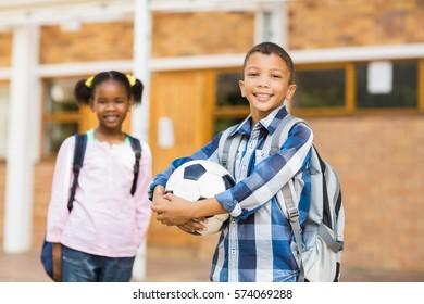 Portrait of smiling kids standing in classroom at school