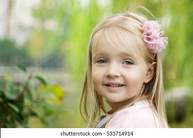 portrait of a smiling little girl on the street
