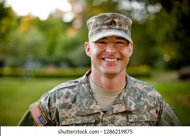 Portrait of a smiling male soldier.