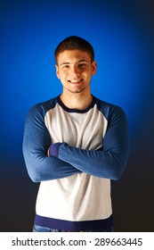 Portrait of smiling man against blue background