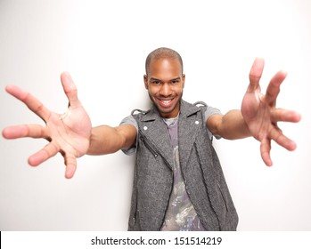 Portrait of a smiling man with arms outstretched and hands open