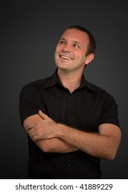 Portrait of a smiling man in a black shirt