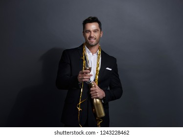 Portrait of smiling man drinking champagne