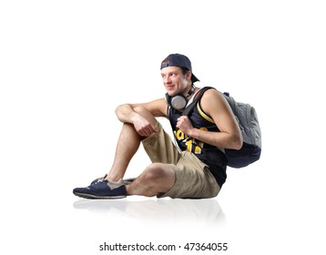 Portrait of a smiling man with headphones and rucksack