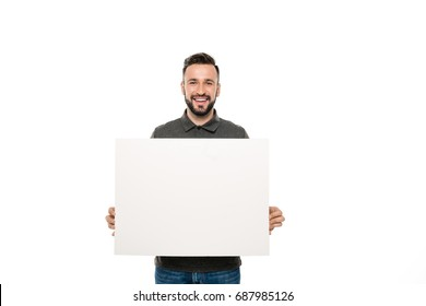 portrait of smiling man holding blank banner in hands isolated on white