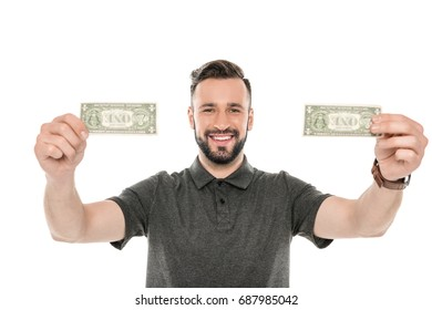 portrait of smiling man holding dollar banknotes in hands isolated on white