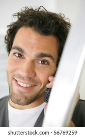Portrait of a smiling man with mobile phone