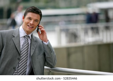 Portrait of a smiling man with a phone