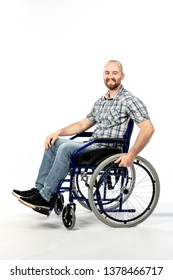 portrait of a smiling man sitting on a wheelchair and engaged in physical rehabilitation following an injury.