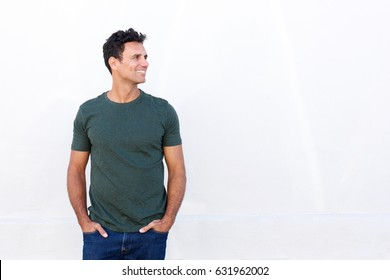 Portrait of smiling man in t-shirt standing against white background