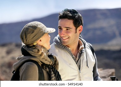Portrait of a smiling man watching a woman