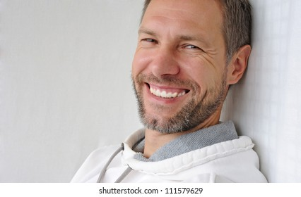 Portrait of smiling man in white